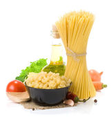Raw pasta and healthy food — Stock Photo