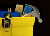 Set of tools in toolbox on black — Stock Photo