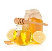 Jar full of honey and lemon — Stock Photo