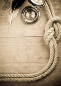 Ship ropes and compass on woo — Stock Photo