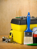 Tools and toolbox on wood — Stock Photo