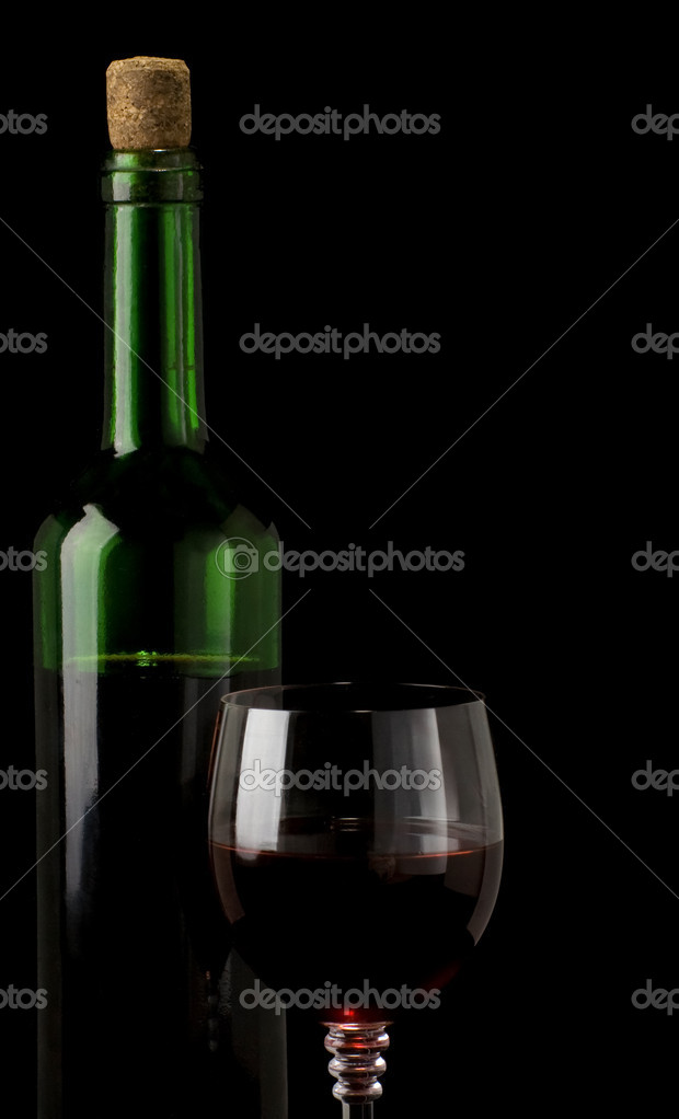 Glass of red wine isolated on black background — Stock Photo #10712921