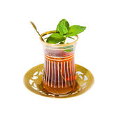 Arabian tea in oriental tea set with mint leaves — Stock Photo