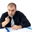 Serious business man arguing and looking at camera — Stock Photo