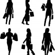 A collection of silhouettes of women shopping — Stock Vector