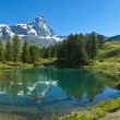 Stock Photo: Blue lake and Mount Cervino