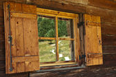 Reflections in the window of the refuge — Stock Photo