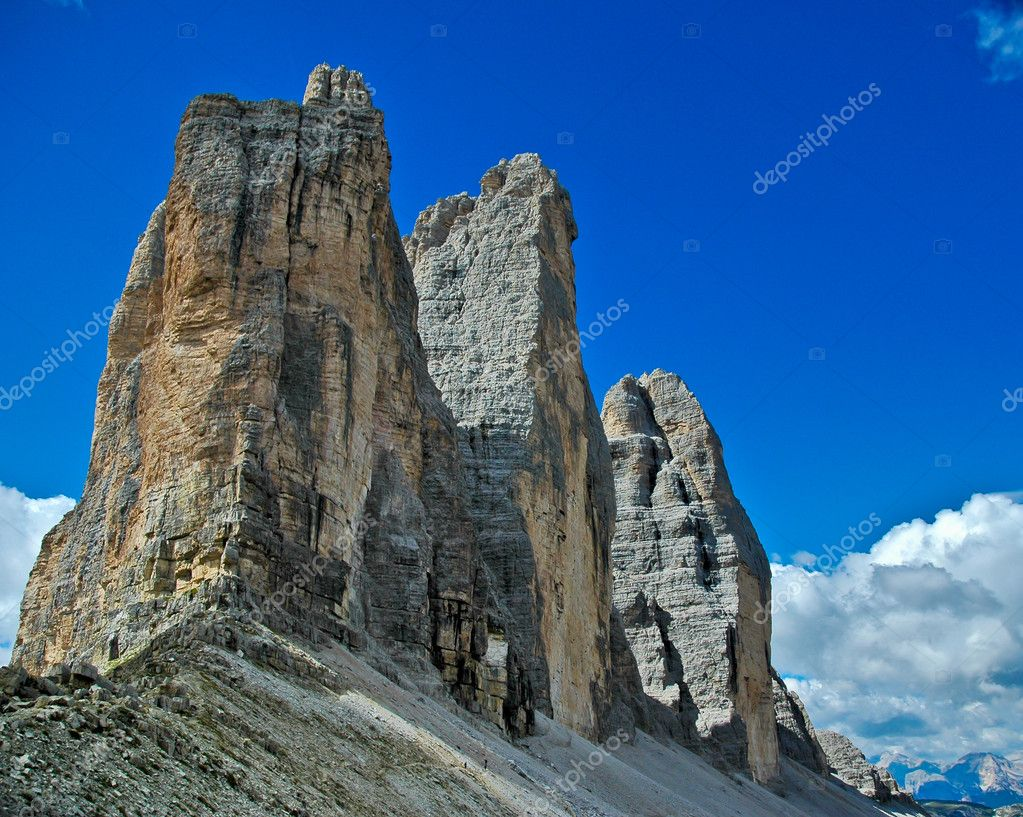 The most famous Dolomite peaks in contrast with the blue sky  Stock Photo #10726168