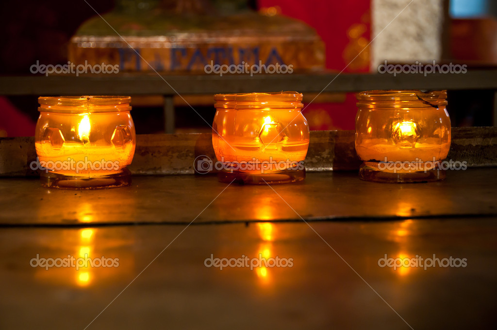 Three candles: a moment of faith, meditation and prayer — Stock Photo #10727189