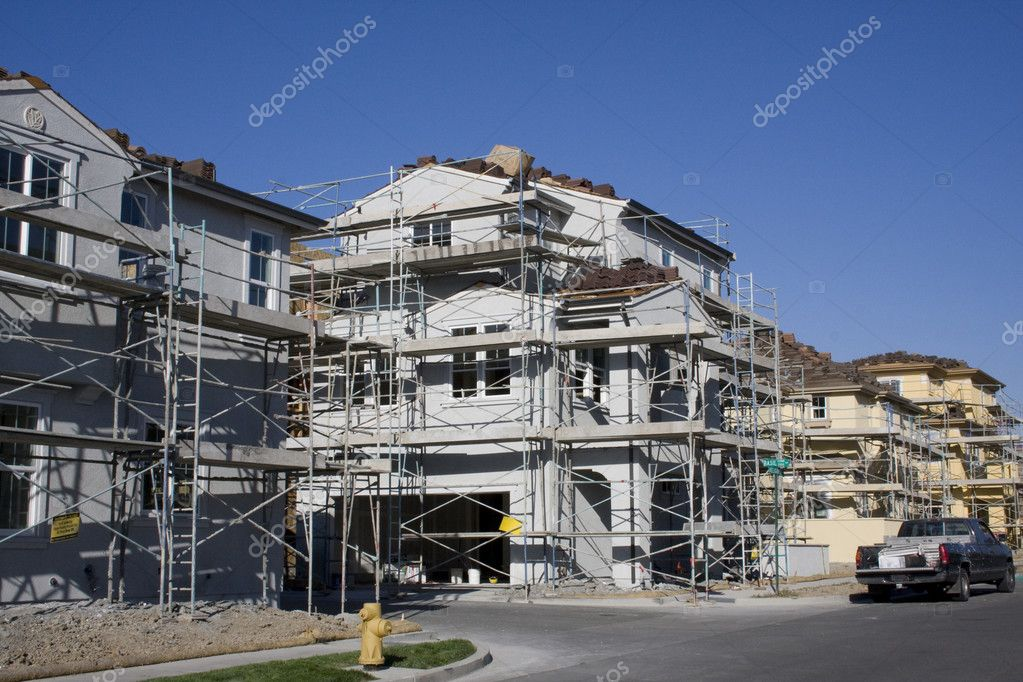 New home construction with scaffolding  Stock Photo #10687851