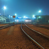 Railway tracks at night — Stock Photo
