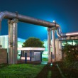 Stock Photo: Industrial pipes at night