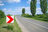 Right arrow sign on the curvy road — Stock Photo