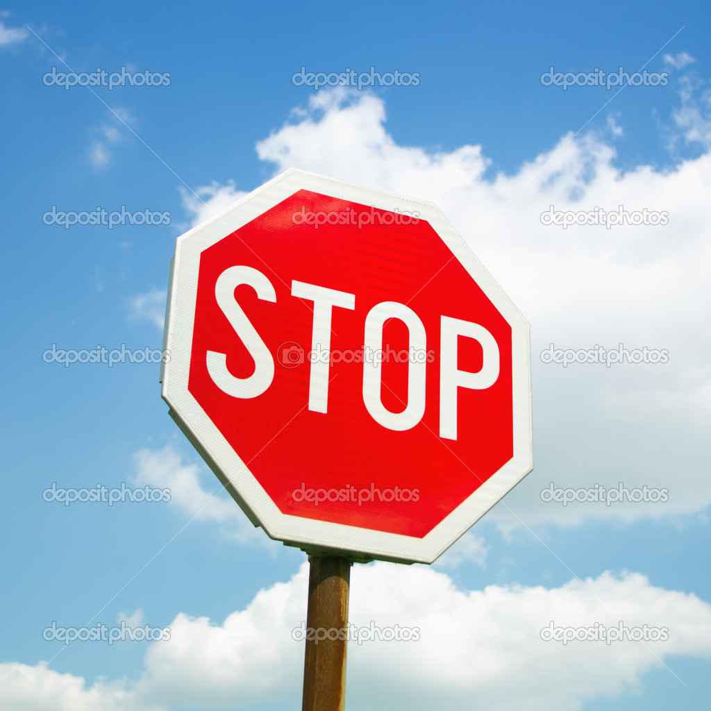 Stop sign over cloudy sky — Stock Photo #10682308