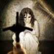 Exorcism and woman possessed by devil — Stock Photo #10683562