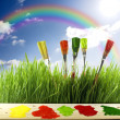 Brushes colors of nature with rainbow and sun — Stock Photo #10689064