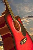 Guitar and romantic sky — Stock Photo