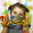 Kid playing with paint — Stock Photo