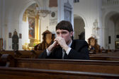 Prayer in church — Stock Photo