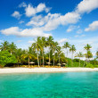 Tropical island palm beach with beautiful blue sky — Stock Photo