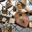 Stock Photo: Padlock on bridge over river Seine in Paris