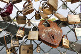 Padlock on the bridge over river Seine in Paris — Stock Photo