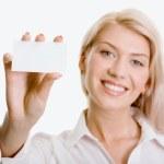 Beautiful woman holding a business card — Stock Photo #10709527