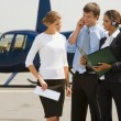 Business questions on helipad - Stock Photo