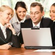 Group of businesspeople working on the laptop — Stock Photo