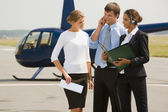 Business questions on helipad — Stock Photo