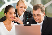 Businesspeople looking at the laptop — Stock Photo