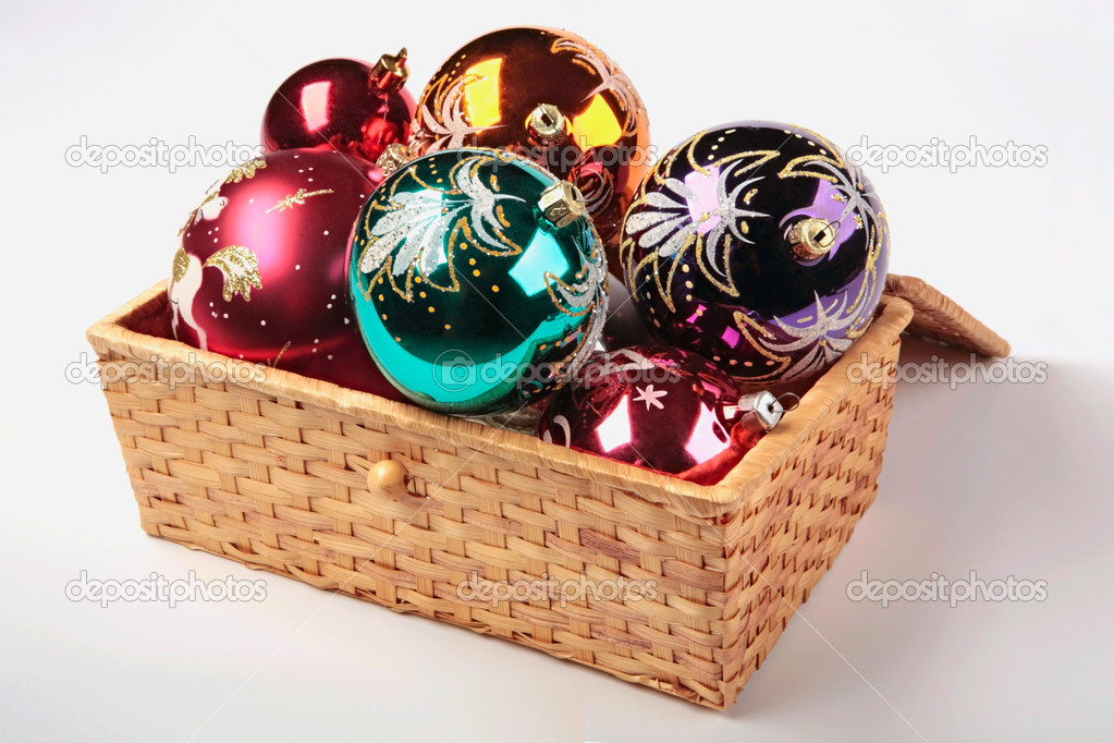 Christmas tree decorations in the basket on a white background — Zdjęcie stockowe #10709224