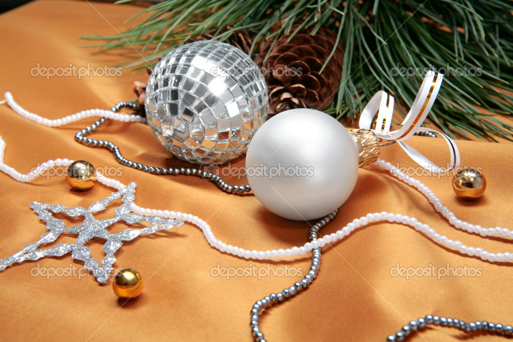 Christmas details: balls, beads and part of a christmas twig with fir cone — Stock Photo #10709227