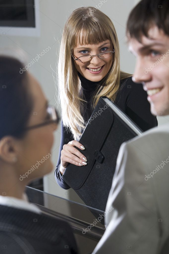 Portrait of smiling businesswoman in the company of her colleagues — Stock Photo #10709318