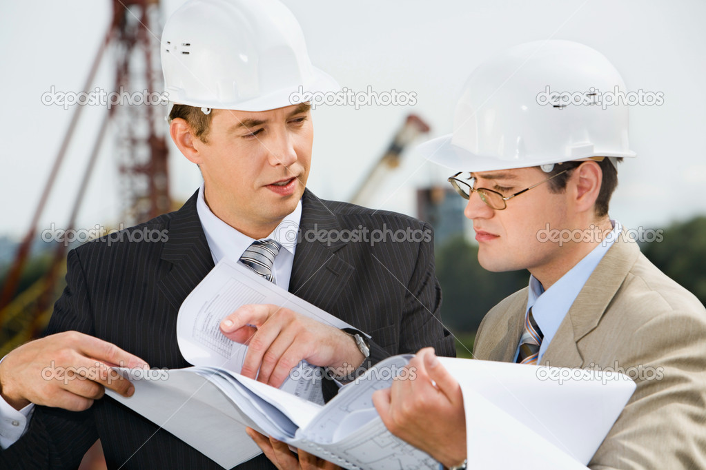 Successful architect is explaining  a conditions of project to the customer  Stock Photo #10709379