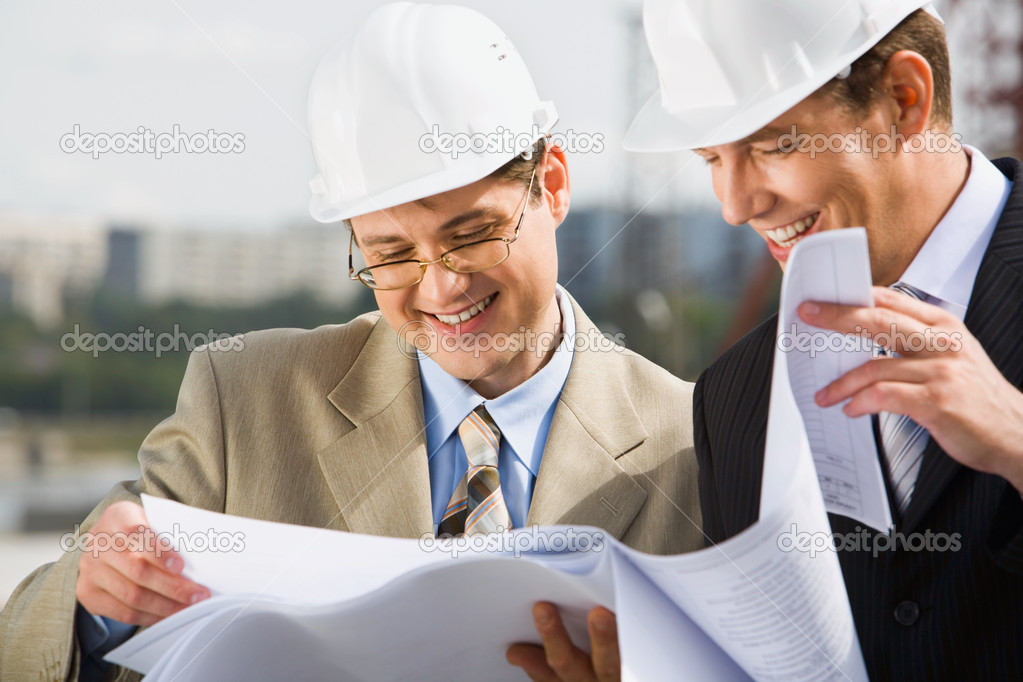 Confident architect  is proposing a new plan of building to his chief — Stock Photo #10709382