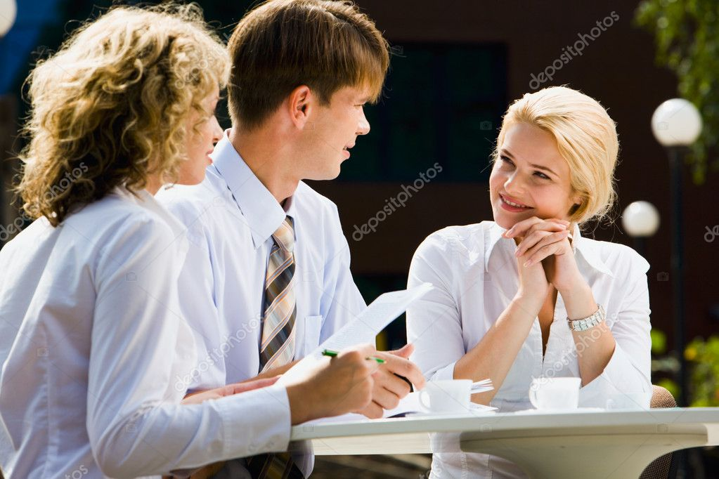 Successful businesspeople are speaking about work in the cafe  Stock Photo #10709532