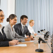 Stock Photo: Photo of business sitting at the table at seminar