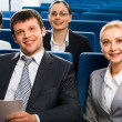 Stock Photo: Successful business listening to the teacher at seminar