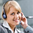 Portrait of friendly customer service representative during work — Stock Photo