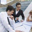 Team of young professionals studying sketches, drawings and documents  — Stock Photo