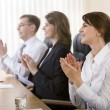 Stock Photo: Image of successful business clapping in the office