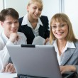 Group of three business looking at monitor — Stock Photo #10710495