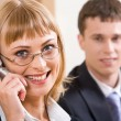 Portrait of beautiful business woman calling on the telephone - Stock Photo