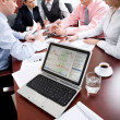 Image of laptop on workplace with associates talking on background — Stock Photo #10710996