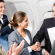 Royalty-Free Stock Photo: Handshake in the plane