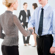 Photo of successful business partners handshaking after striking great deal — Stock Photo