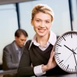 Stock Photo: Portrait of responsible womwith watch in office