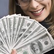 Royalty-Free Stock Photo: Beautiful businesswoman holding money.