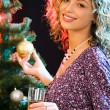 Woman and christmas-tree — Stock Photo